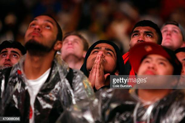 Fans in Jurassic Park out front of Air Canada Centre react to a play as they watch game 2 of the Toronto Raptors playoff series against the...