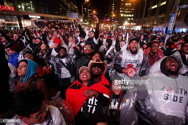 Fans in Jurassic Park out front of Air Canada Centre watch game 2 of the Toronto Raptors playoff series against the Washington Wizards