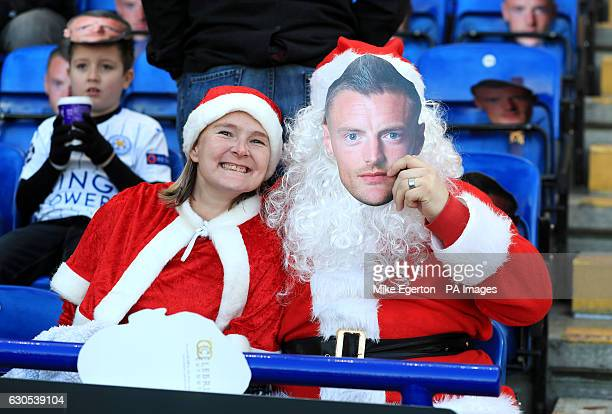Fans in Santa Claus fancy dress and face masks of Leicester City's Jamie Vardy in the stands before the Premier League match at the King Power...
