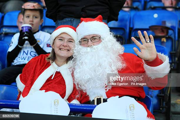 Fans in Santa Claus fancy dress in the stands before the Premier League match at the King Power Stadium Leicester