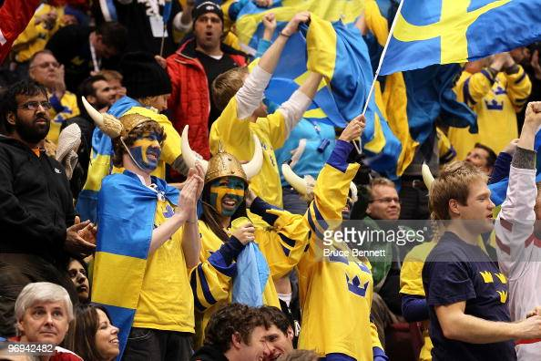 Fans in support of Sweden support their team against Finland during the ice hockey men's preliminary game between Sweden and Finland on day 10 of the...
