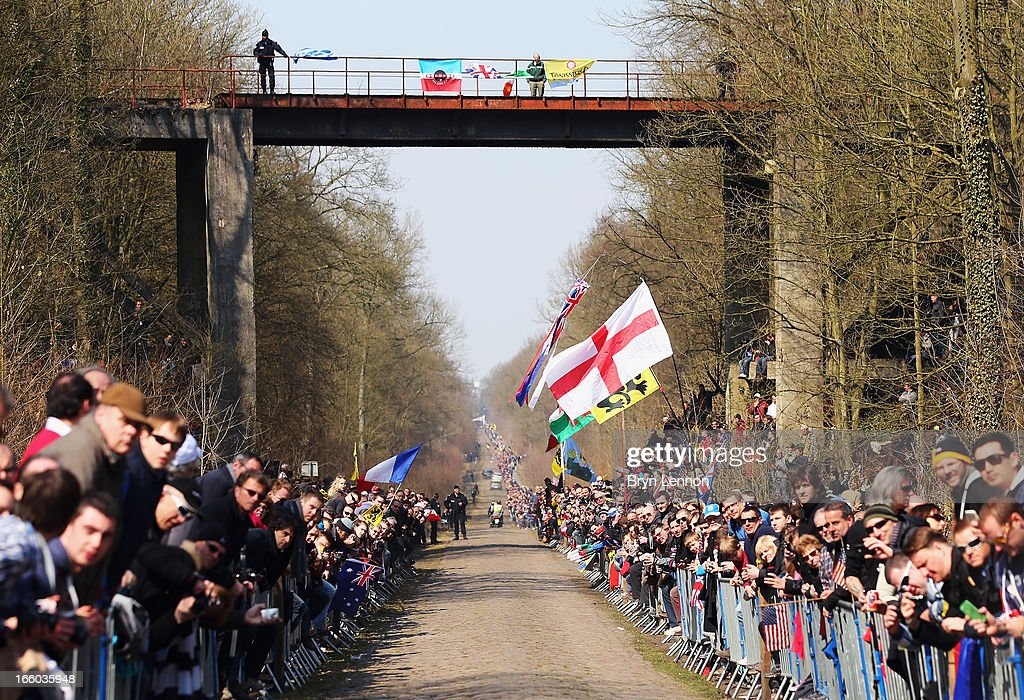 Fans in the Arenberg Forest wait for the race to pass by during the 2013 Paris - Roubaix race from Compiegne to Roubaix on April 7, 2013 in Roubaix, France. The 111th Paris - Roubaix race is 254km long and contains 27 sections of cobblestones.