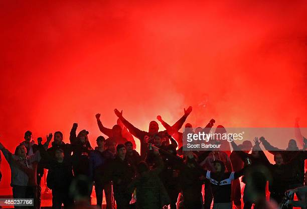 Fans in the crowd let off flares during the FFA Cup Round of 16 match between Heidelberg United and Sydney United 58 FC at Olympic Village on August...