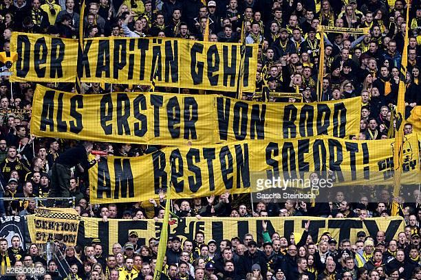 Fans in the Dortmund stand show a banner 'Der Kapitaen geht als erster von Bord Am besten sofort' according to Mats Hummels during the Bundesliga...