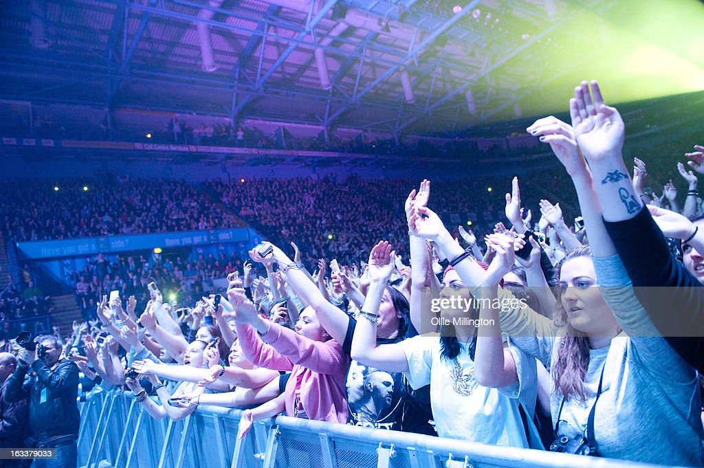 fans in the front row watch as The Script perform on stage in concert on the opening night of the bands March 2013 UK Tour during the #3 World Tour at Nottingham Capital FM Arena on March 8, 2013 in Nottingham, England.