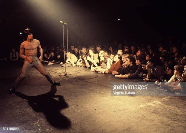 Fans in the front rows of the audience watch Iggy Pop performing on stage in Aylesbury United Kingdom 2 February 1980