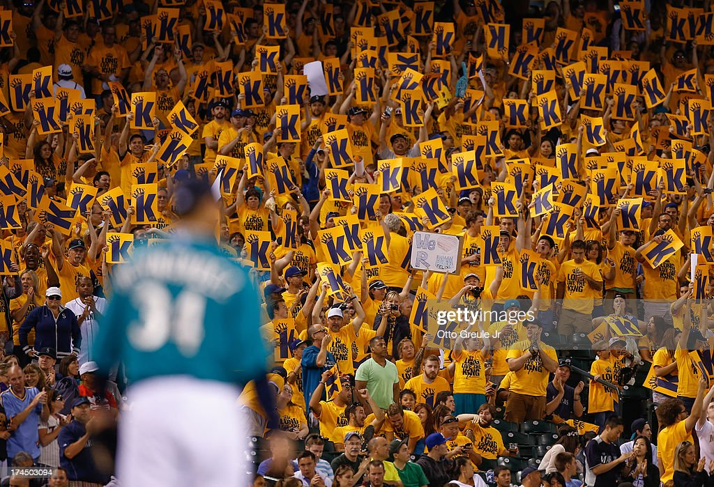 Fans in the King's Court section cheer as starting pitcher <a gi-track='captionPersonalityLinkClicked' href=/galleries/search?phrase=Felix+Hernandez&family=editorial&specificpeople=550749 ng-click='$event.stopPropagation()'>Felix Hernandez</a> #34 of the Seattle Mariners takes the field in the ninth inning against the Minnesota Twins at Safeco Field on July 26, 2013 in Seattle, Washington.