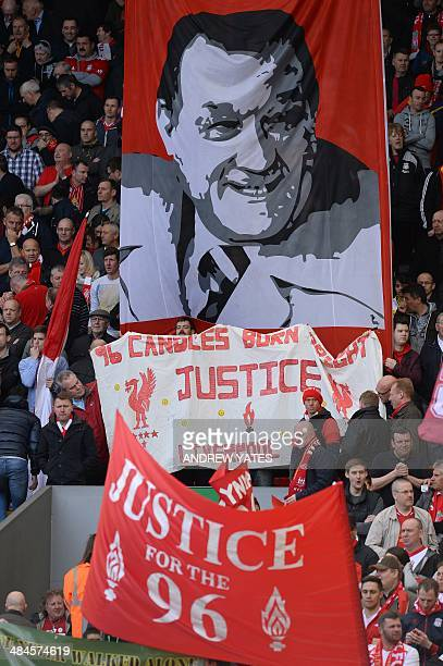 Fans in the Kop wave banners in memory of victims of the 1989 Hillsborough disaster before the English Premier League football match between...
