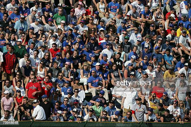 Fans in the left field bleachers enjoy the weather as the Chicago Cubs take on the St Louis Cardinals on April 22 2007 at Wrigley Field in Chicago...