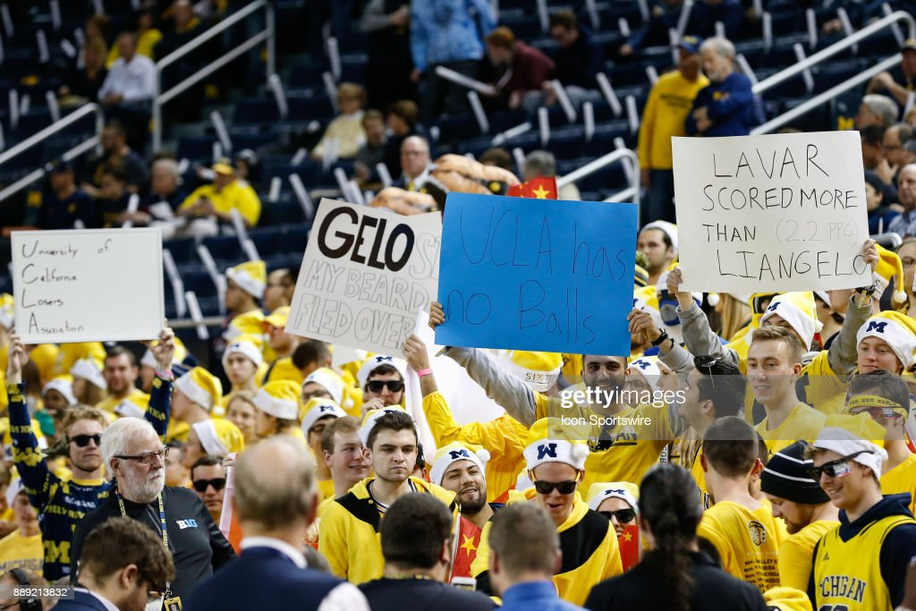 Fans in the Michigan student section hold signs taunting UCLA and former player LiAngelo Ball before the start of a regular season non-conference basketball game between the UCLA Bruins and the Michigan Wolverines on December 9, 2017 at the Crisler Center in Ann Arbor, Michigan. Michigan defeated UCLA 78-69 in overtime.
