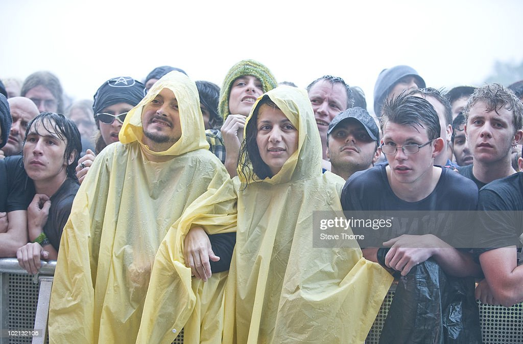 Fans in the rain wearing waterproofs while in the crowd watching Stone Temple Pilots perform on stage on the last day of Download Festival at Donington Park on June 13, 2010 in Castle Donington, England.