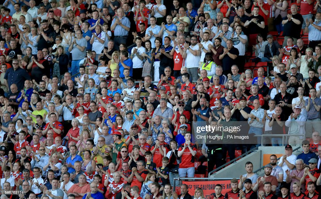 Fans in the stands applaud 22 minutes into the game in respect for the victims of the Manchester terror attack during the Betfred Super League match at the AJ Bell Stadium, Salford.