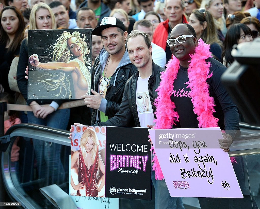 Fans, including entertainer Larry Edwards (R) of Nevada, hold signs as they wait for Britney Spears to arrive at a welcome ceremony as she celebrates the release of her new album 'Britney Jean' and prepares for her two-year residency at Planet Hollywood Resort & Casino on December 3, 2013 in Las Vegas, Nevada. Spears' show 'Britney: Piece of Me' will debut at the resort on December 27, 2013.
