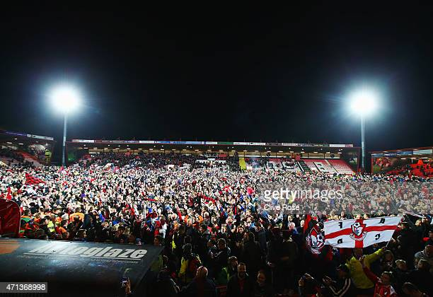 Fans invade the pitch after victory in the Sky Bet Championship match between AFC Bournemouth and Bolton Wanderers at Goldsands Stadium on April 27...