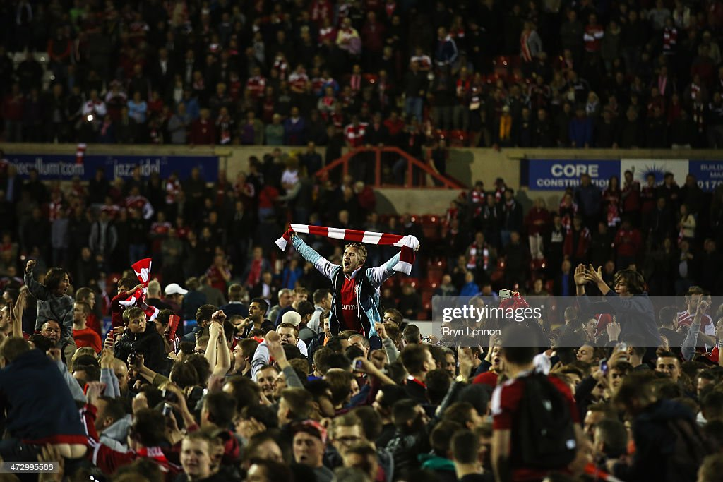 Fans invade the pitch at full time after the Sky Bet League 1 Playoff SemiFinal between Swindon Town and Sheffiled United at County Ground on May 11...