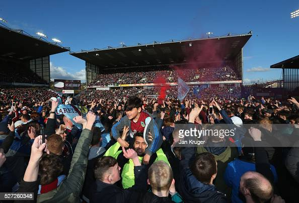 Fans invade the pitch in celebration as Burnley are promoted to the Premier League after the Sky Bet Championship match between Burnley and Queens...