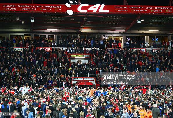 Fans invade the pitch to celebrate victory after the Sky Bet Championship match between AFC Bournemouth and Bolton Wanderers at Goldsands Stadium on...