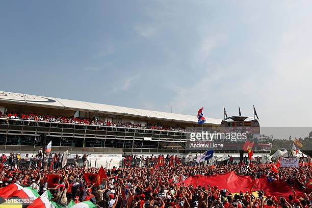 Fans invade the track for the podium celebrations following the Italian Formula One Grand Prix at the Autodromo Nazionale di Monza on September 9...