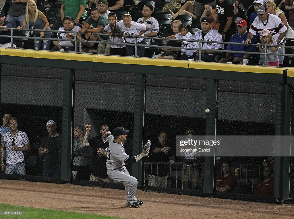 Fans jeer Nick Swisher #33 of the New York Yankees as he plays a ball off of the wall against the Chicago White Sox at U.S. Cellular Field on August 3, 2011 in Chicago, Illinois. The Yankees defeated the White Sox 18-7.