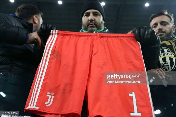 fans Juventus with Buffon's Sport Shorts of during the UEFA Champions League group D match between Juventus and FC Barcelona at Allianz Stadium on...