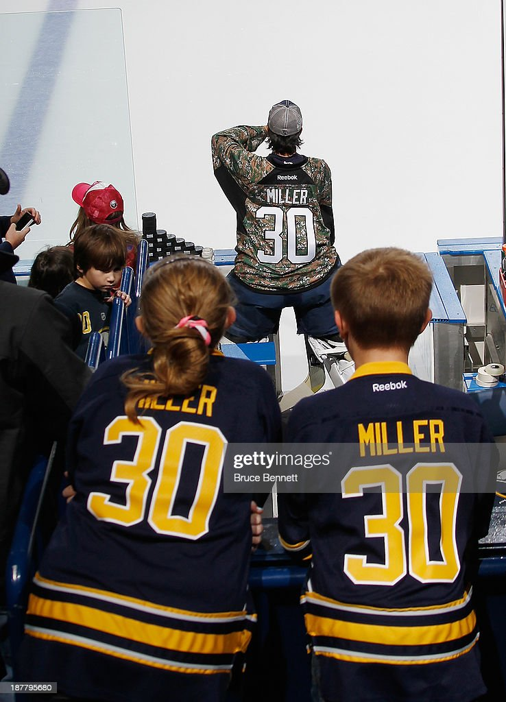 Fans keep an eye on Ryan Miller #30 of the Buffalo Sabres as he waits for warmup ice to be ready prior to the game against the Los Angeles Kings at the First Niagara Center on November 12, 2013 in Buffalo, New York.