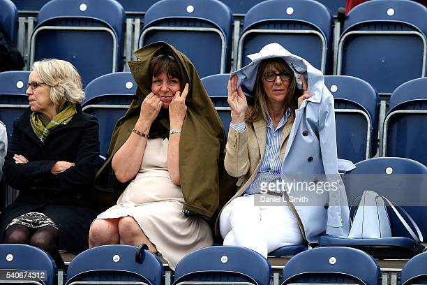 Fans keep dry during the womens singles match between Emily Appleton of Great Britain and Cindy Burger of Netherlands during the Aegon Ilkley Trophy...