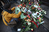 Fans lay flowers at the doorstep at the building where British musician David Bowie once lived following the announcement of his death on January 11...