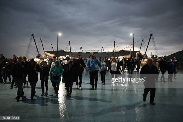 Fans leave the Etihad stadium in Manchester northwest England on September 13 2016 after the UEFA Champions League group C football match between...