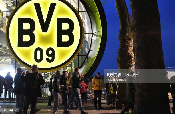 Fans leave the Signal Iduna Park area after the match between Borussia Dortmund and AS Monaco was cancelled after the team bus of the Borussia...