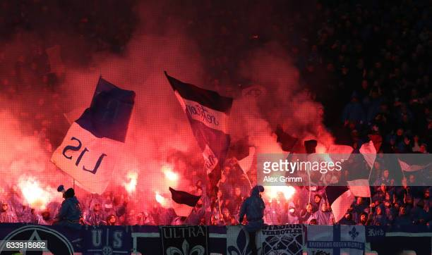 Fans let off flares during the Bundesliga match between Eintracht Frankfurt and SV Darmstadt 98 at CommerzbankArena on February 5 2017 in Frankfurt...
