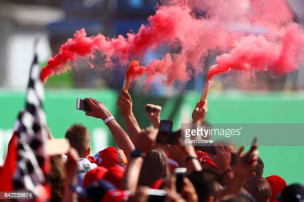 Fans light flares at the podium celebrations during the Formula One Grand Prix of Italy at Autodromo di Monza on September 3 2017 in Monza Italy