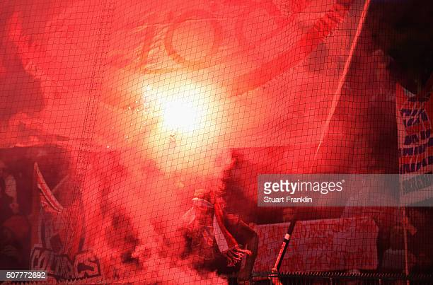 Fans light flares during the Bundesliga match between VfL Wolfsburg and 1 FC Koeln at Volkswagen Arena on January 31 2016 in Wolfsburg Germany