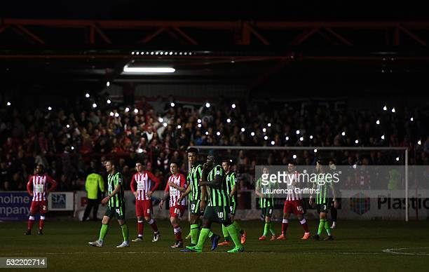 Fans light the stadium up with their mobile phones after a floodlight failure during the Sky Bet League Two play off Second Leg match between...