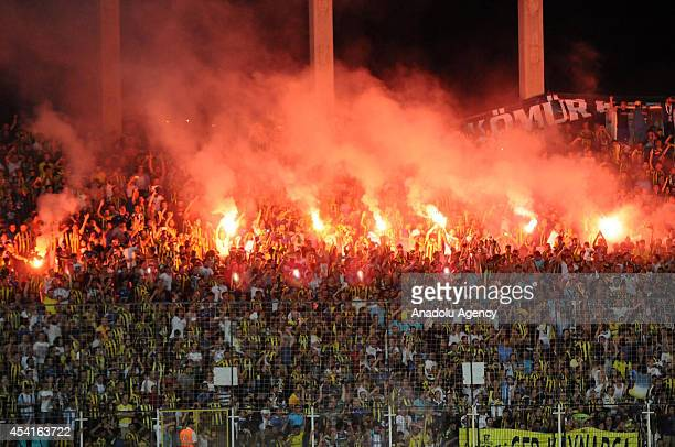 Fans light torches during the 2014 Turkish Super Cup final between the champion of Spor Toto Super League Fenerbahce and Ziraat Turkish Cup winner...