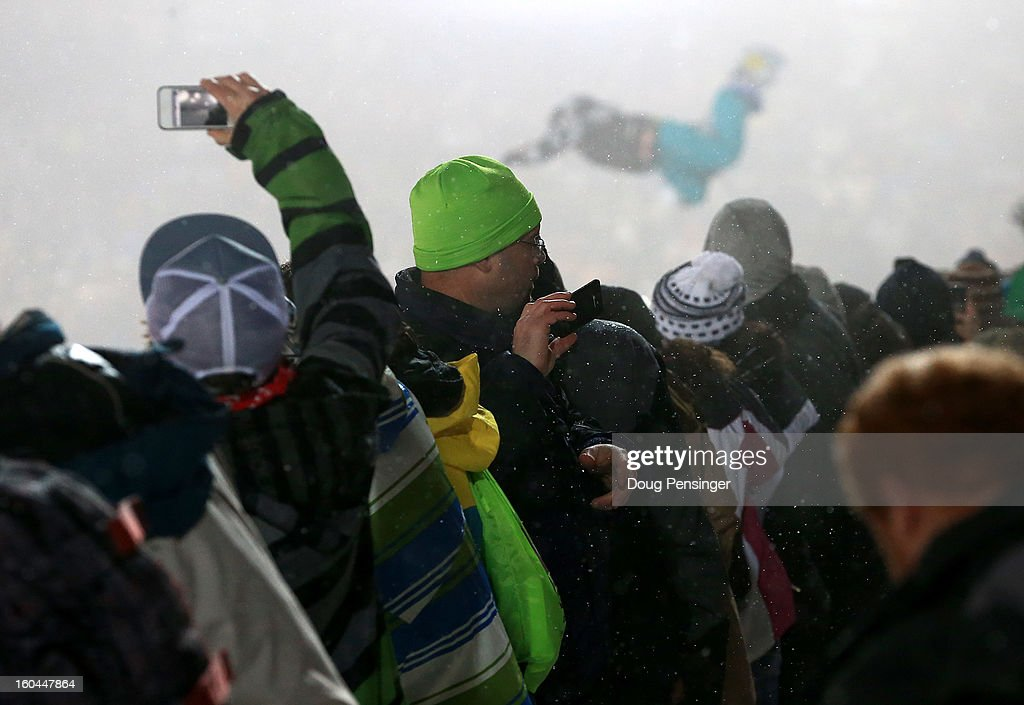 Fans line the deck of the halfpipe to spectate the Women's Snowboard Superpipe Final during Winter X Games Aspen 2013 at Buttermilk Mountain on January 26, 2013 in Aspen, Colorado.