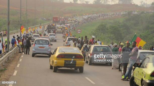 Fans line the exit ramp February 6 2017 at Yaoundé Nsimalen International Airport near the capital Yaoundé Cameroon during celebrations on the return...