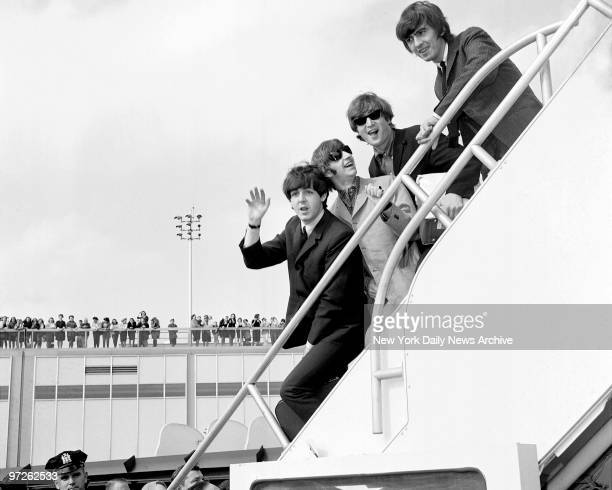 Fans line the rooftop at Kennedy International Airport for a last glimpse of the Beatles Paul McCartney Ringo Starr John Lennon and George Harrison...