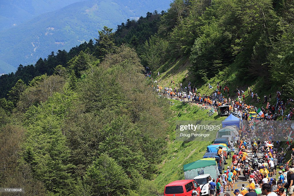 Fans line the route on the climb of the La Hourquette d'Ancizan during stage nine of the 2013 Tour de France, a 168.5KM road stage from Saint-Girons to Bagneres-de-Bigorre, on July 7, 2013 in Bagneres-de-Bigorre, France.