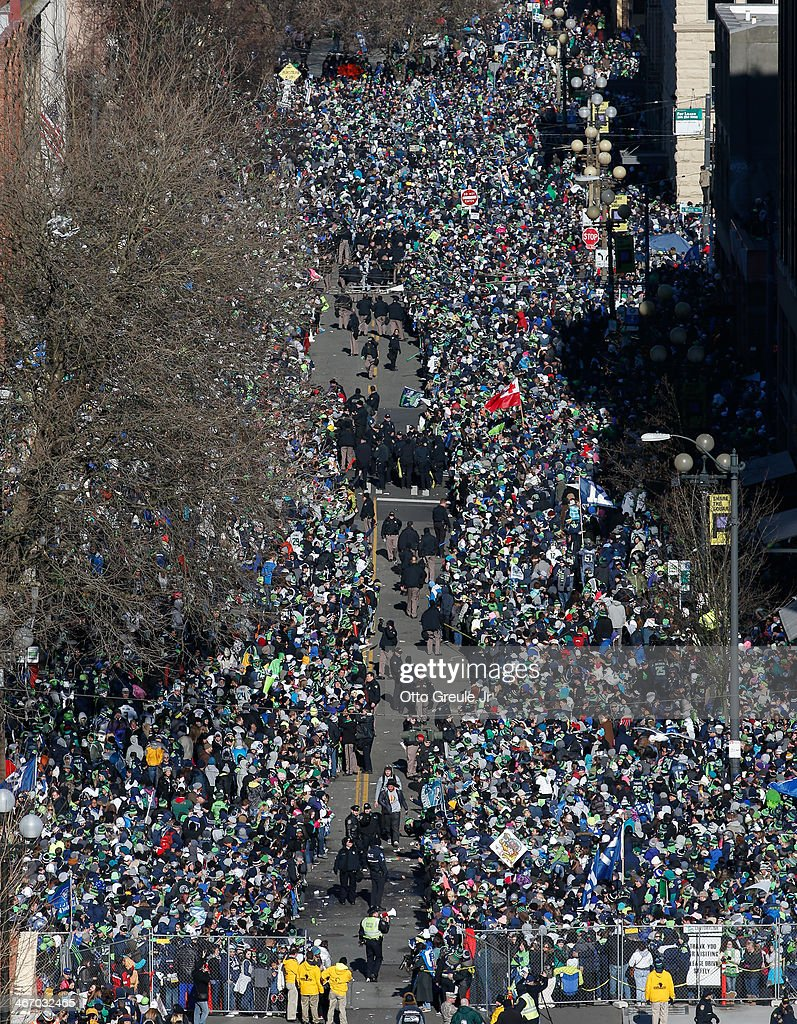 Fans line the street awaiting the start of the Seahawks' Super Bowl XLVIII Victory Parade on February 5, 2014 in Seattle, Washington.