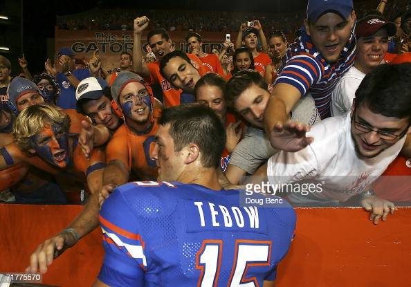 Fans line up and reach out to touch quarterback Tim Tebow of the University of Florida Gators after defeating the Southern Miss Golden Eagles at Ben...