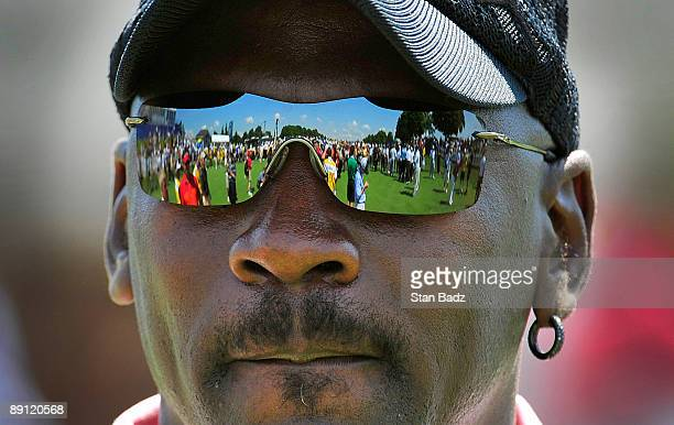 Fans line up for an autograph as reflected in Michael Jordan's sun glasses during the RBC Canadian Open's Mike Weir Charity Classic ProAm at Glen...