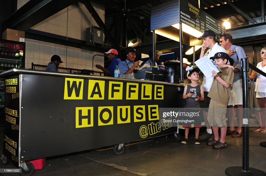 Fans line up for food at Waffle House, the newest restaurant vendor to open at Turner Field, before the game between the Atlanta Braves and the Miami Marlins on August 11, 2013 in Atlanta, Georgia.