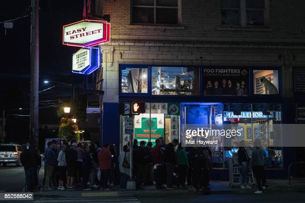 Fans line up outside for a chance to meet Macklemore during a listening party for his newly released solo album 'Gemini' at Easy Street Records on...
