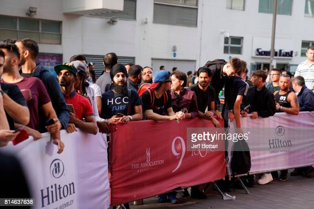 Fans line up outside of the Hilton London Wembley prior to the Floyd Mayweather Jr v Conor McGregor World Press Tour event at SSE Arena on July 14...