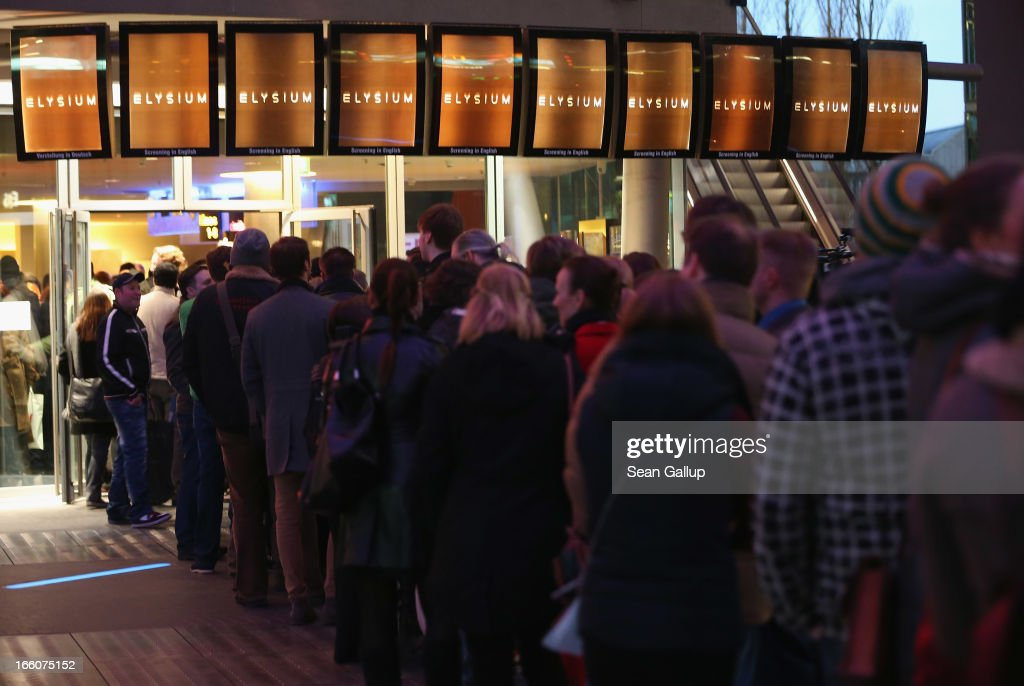 Fans line up to attend the trailer launch event for 'Elysium' at the CineStar on April 8, 2013 in Berlin, Germany.