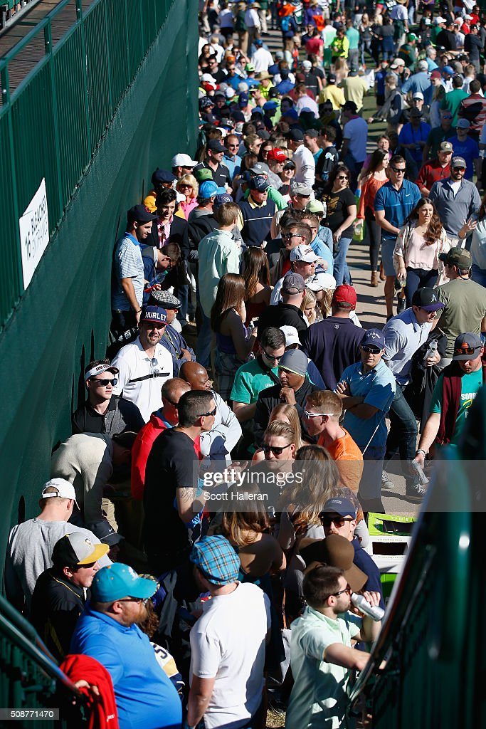 Fans line up to go into the 16th hole during the third round of the Waste Management Phoenix Open at TPC Scottsdale on February 6, 2016 in Scottsdale, Arizona.