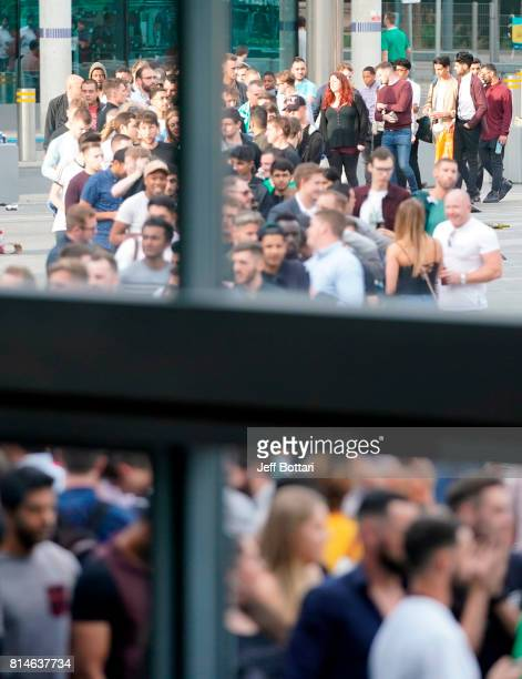 Fans lineup outside prior to the Floyd Mayweather Jr v Conor McGregor World Press Tour event at SSE Arena on July 14 2017 in London England