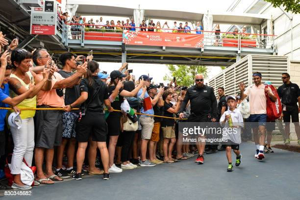 Fans lineup to watch Roger Federer of Switzerland walk towards the tunnel prior to his match against Roberto Bautista Agut of Spain during day eight...