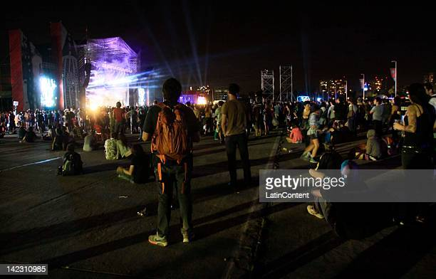 Fans listen to Brithish singer Dave Grohl of Foo Figthers performs live on stage during the 2012 Lollapalooza Music Festival at OHiggins Park on...