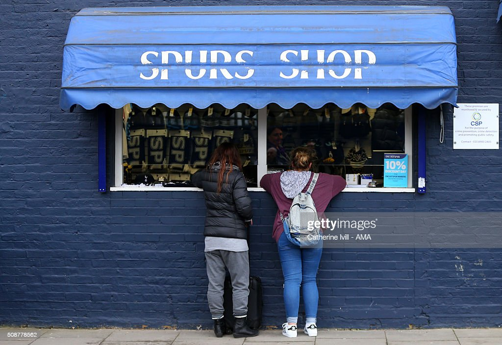 Fans look at merchandise at the Spurs shop prior to the Barclays Premier League match between Tottenham Hotspur and Watford at White Hart Lane on February 6, 2016 in London, England.